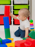 Child builds a tower of cubes Stock Images