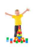 Child builds town of colored cubes Stock Photography