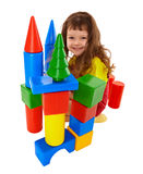 Child built a castle from color cubes Stock Photos