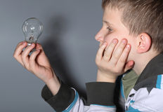 Child with bulb Royalty Free Stock Photos