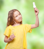 Child with bulbs Royalty Free Stock Images