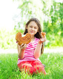Child and bun Stock Photo
