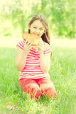 Child and bun Royalty Free Stock Image