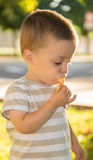 Child with a bun. Portrait of a child eating a bun Royalty Free Stock Photo