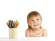 Child with bunch of color crayons Stock Image