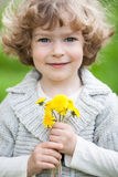 Child with bunch of dandelion Royalty Free Stock Photography