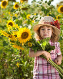 Child with bunch of sunflowers Stock Photography