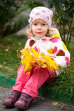 Child with bunch of yellow leaves Stock Photo