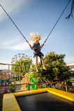 Child on bungee attraction Stock Photo