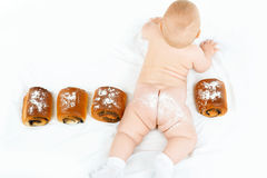 Child and buns. With icing on white background royalty free stock image
