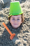 Child buried in the sand Royalty Free Stock Photos