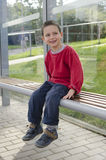 Child at bus stop Royalty Free Stock Photography