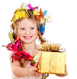 Child with butterfly holding gift box. Royalty Free Stock Photos