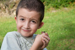 Child with butterfly. Child holding a butterfly on hand Stock Image
