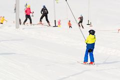 Child on a button ski lift going uphill Royalty Free Stock Images
