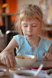 The child in cafe. Eat potato Royalty Free Stock Images