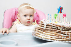Child with a cake Stock Photos