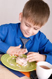 Child with cake Stock Image