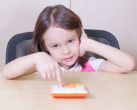 Child with a calculator Stock Photography