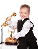 Child calling by phone. Royalty Free Stock Photography