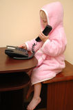 Child calls by phone Stock Photo
