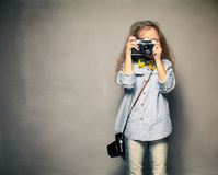 Child with camera. Stock Photos