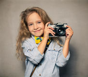 Child with camera. Royalty Free Stock Photo