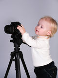 A child with a camera in the studio Stock Images