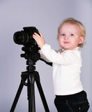 A child with a camera in the studio Royalty Free Stock Photo