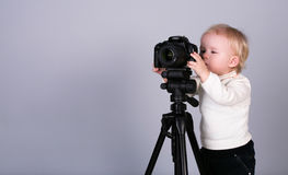 A child with a camera in the studio Royalty Free Stock Image