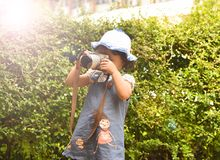 Child camera Take Photo photograph Young photographer child taking photos with camera Royalty Free Stock Photography