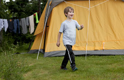 Child at campground by tent Royalty Free Stock Image