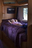 Child in camping caravan Stock Image