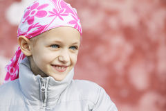 Child with cancer. Beautiful caucasian girl wearing a head scarf due to hair loss from chemotherapy fighting cancer stock photography