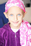 Child with cancer. A caucasian child wearing a head scarf as her hair starts to fall due to the effects of chemotherapy Royalty Free Stock Photo