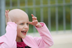Child with cancer. Happy child who lost her hair due to chemotherapy to cure cancer Stock Images