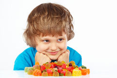Child with candies on white background Royalty Free Stock Photo
