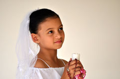 Child with candle and rosary beads Royalty Free Stock Photo