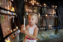 Child with candles Stock Images