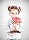 Child with candy Royalty Free Stock Image