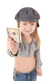 Child in cap. Gavroche. Friendly girl in walking clothing with money. Focus on money Stock Photography