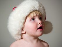 Child in cap looks Royalty Free Stock Photo