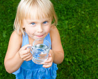 Child with cap of water Stock Photo