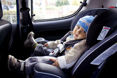 Child in car. Sweet child in new car Royalty Free Stock Photo