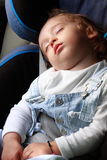 Child in car. Sleeping child in the car for visual Stock Photo