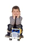 Child with car. The child with the toy car on a white background Royalty Free Stock Images
