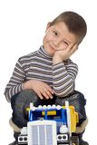 Child with car. The child with the toy car on a white background Royalty Free Stock Photos