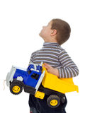 Child with car. The child with the toy car on a white background Stock Photo