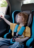 Child in a car. Travelling with safety - little girl in a car Stock Photography