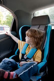 Child in a car Stock Images